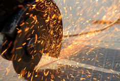 Sparks from an angle grinder. Angle grinder cutting through metal and sparks are flying Stock Photos