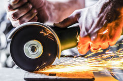 Sparks from the angle grinder Stock Photo