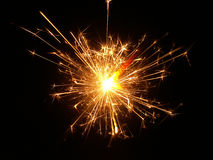 Sparks of bengal fire on a black background Stock Images
