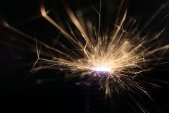 Sparks on a black background electric short circuit Stock Photos