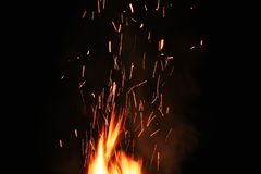 Sparks on a black background. Sparks of fire. royalty free stock image