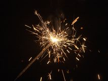 Sparks of burning pyrotechnics. On a black background royalty free stock image