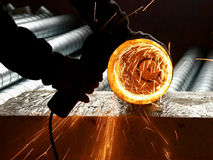 Sparks in a circle when cutting pipes Royalty Free Stock Photos