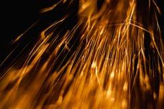 Sparks comet-like in dark Stock Photography