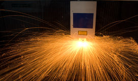 Sparks from computerised fabrication machine Royalty Free Stock Photos