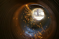 Sparks in culvert Stock Photo