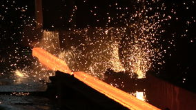 Sparks from the cutting of the red-hot billet circular saw stock video