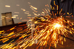 Sparks while cutting steel Royalty Free Stock Image