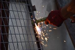 Sparks from digging the gates in my garden stock photography