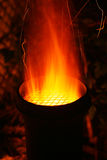 Sparks and Fire. Coming out of the top of a chiminea royalty free stock photos