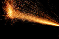 Sparks of Fire on Black. Sparks of fire arising in the process of metal cutting on black Royalty Free Stock Images
