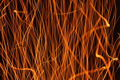 Sparks from a fire light trail Stock Image