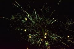 Sparks of Fireworks in the dark sky. A celebrating night of fireworks decorates the black sky with a spectacular display royalty free stock images
