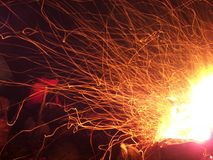 Sparks and flares of a night fire in the forest stock image