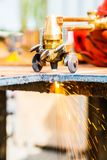 Closeup cutting plate steel with arc welder. Sparks fly in closeup cutting plate steel with arc welder Stock Photos