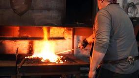Blacksmith warms the stove