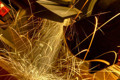 Sparks Fly from a Workshop Grinder Royalty Free Stock Photo