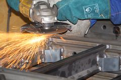 Sparks flying from a grinder Royalty Free Stock Photo