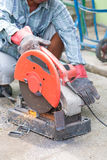 Sparks flying metal cutting abrasive disk by worke. R on the floor Royalty Free Stock Photo