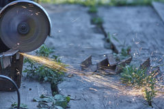 Free Sparks From Circ Saw, Buzz Saw, Iron, Wood Floor, Green Grass Royalty Free Stock Photography - 66030287