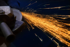 Sparks from the grinder Royalty Free Stock Image