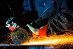 Sparks while grinding iron. Metal sparks while grinding iron Royalty Free Stock Photo