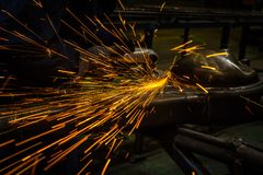 Sparks while grinding iron royalty free stock images