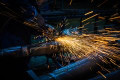 Sparks while grinding iron royalty free stock photo
