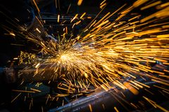 Sparks while grinding iron royalty free stock photos