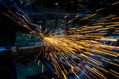 Sparks while grinding iron royalty free stock photography