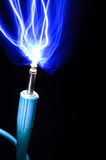 Sparks from a guitar plug. Blue Sparks from a guitar plug Royalty Free Stock Photo