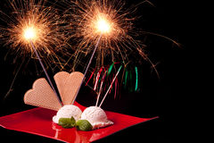 Sparks on ice cream Stock Images