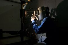 Sparks, mask, and smoke. Welder Royalty Free Stock Images