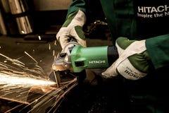 Sparks from mechanical grinder on metal