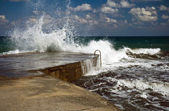 Sparks of Mediterranean sea. Sparks of breaking wave in the Mediterranean sea. Crete island, Greece. Stormy weather Royalty Free Stock Photos