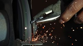 Sparks From Metal Grinder. This stock video features sparks flying off a metal bolt as it is being grinded down stock video footage