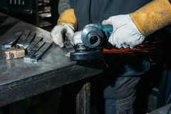 Sparks from metal polishing by the grinder. Industry Stock Photo