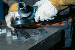 Sparks from metal polishing by the grinder. Industry Stock Photography