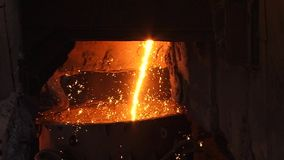 Sparks from molten metal. Foundry - molten metal poured from ladle