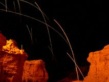 Sparks over rock formations. Steel wool sparks over rock formations at night Stock Images
