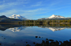 Sparks and Peaks. South Sister and Broken Top peaks as seen from Sparks Lake - near Bend, OR royalty free stock image