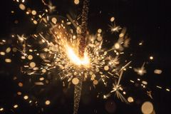Sparks of pyrotechnics. Close up in foreground stock image