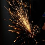 Sparks while sawing metal. close up Stock Image