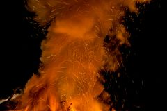 Sparks, smoke and tongues of fire in the night. Bonfire abstract image Stock Photo
