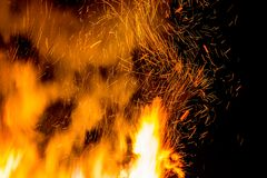 Sparks, smoke and tongues of fire in the night. Bonfire abstract image Stock Photography