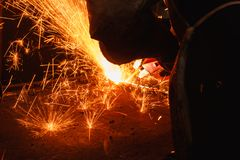 Sparks and smoke from Welder arc Gouging carbon. Electrode rods Royalty Free Stock Image