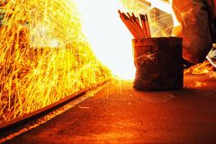Sparks and smoke from Welder arc Gouging carbon. Electrode rods Royalty Free Stock Photo