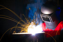 Sparks and smoke while welding. Iron Stock Photo