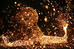 Sparks from steel saw. Cutting steel bars Stock Photo