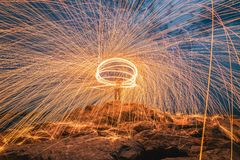 Sparks from steel. Steel wool. Is a beautiful night stock photo